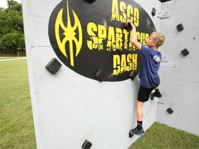 Kid Climbing wall at the AsCO Spartacus Race