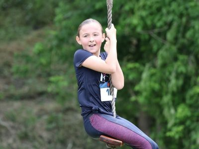 Girl on the Zip Line Obstacle